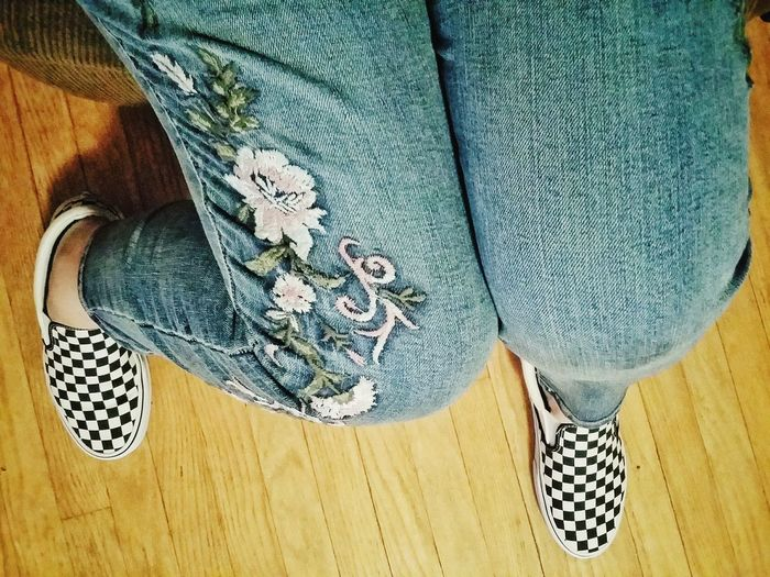 Embroidery Fashion Legs Sitting Low Section Pattern High Angle View Jeans Close-up Fabric Footwear Denim Canvas Shoe Wooden Floor Human Leg Pair