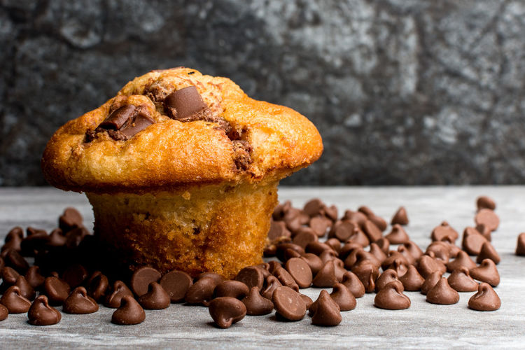 Close-up of muffin with chocolate chips on table