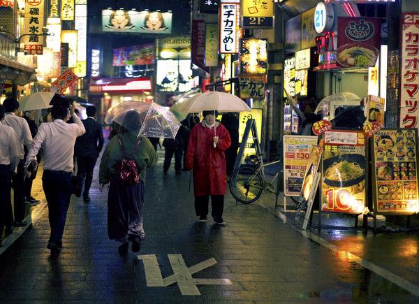 Japan Tokyo Adult Architecture Building Exterior City City Life City Street Crowd Group Of People Illuminated Large Group Of People Lifestyles Night Outdoors Rain Rainy Season Real People Street Text Transportation Umbrella Walking Women