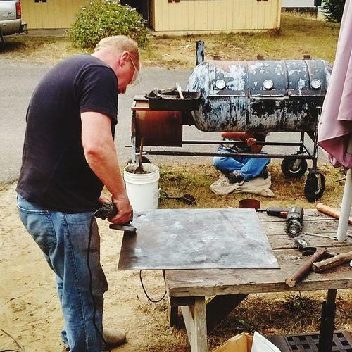 Working Standing Men Real People Outdoors Grinding Metal