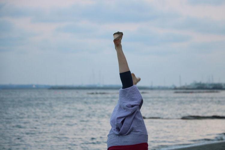 Leisure handstand on beach