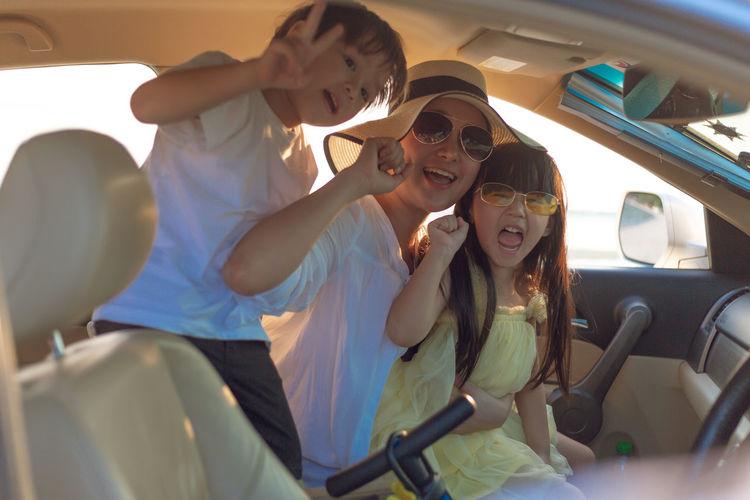 Rear view of women wearing sunglasses