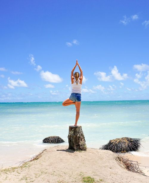 Woman doing yoga Sea Horizon Over Water Water Yoga Beauty In Nature Tranquil Scene Sky One Person Full Length Nature Scenics Arms Raised Real People Day Leisure Activity Balance Outdoors Beach Standing Lifestyles Tree Pose Doing Yoga