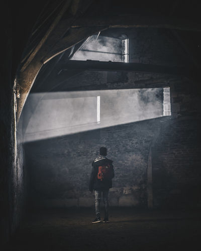 Explore Abandoned Arch Architecture Building Built Structure Casual Clothing Day Full Length Indoors  Leisure Activity Lifestyles Men One Person Real People Rear View Standing Walking Wall - Building Feature