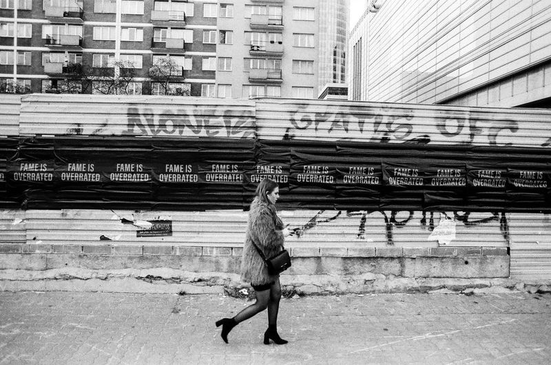 Analog; Nikon FM2 / Ilford PAN 100 The Art Of Street Photography The Week on EyeEm Capture The Moment Everyday Life Nikonphotography Analogue Photography Film Photography Grain Ilford Light And Shadow Warsaw Building Exterior Architecture Built Structure City Day One Person Full Length Real People Men Building Outdoors Motion Transportation Nature Lifestyles Street Casual Clothing Walking City Life