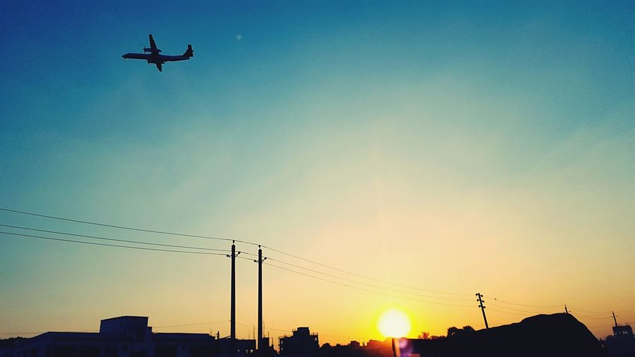 Sunset Low Angle View Flying Silhouette Sky Transportation No People Outdoors Airplane Clear Sky Nature Technology Day