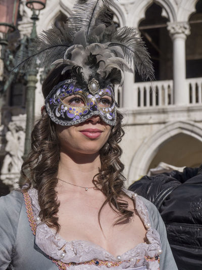 Architecture Building Exterior Built Structure Costume Day Disguise Eye Mask Front View Leisure Activity Lifestyles Looking At Camera Mask - Disguise One Person Outdoors People Portrait Real People Standing Venetian Mask Young Adult Young Women