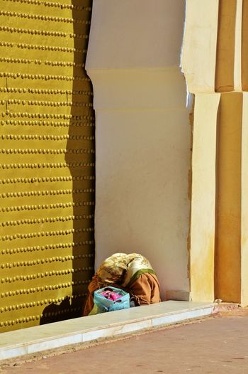 Woman Sitting By Mosque Door