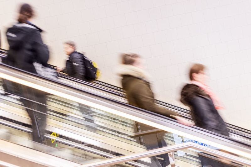people in escalator at rush hour Coworker Busy Modern Consumerism Indoors  City People Commuter Business Person Staircase Men Transportation Adult Women on the move Business Speed Walking Urgency Architecture Group Of People Blurred Motion Motion Escalator
