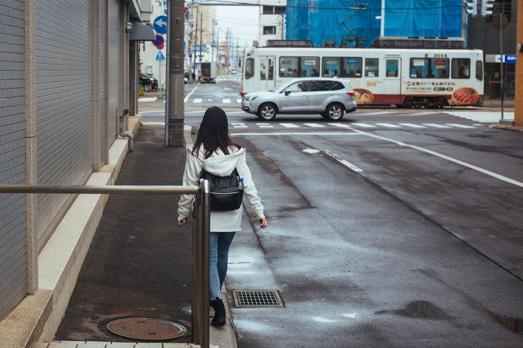Woman walking on streets wandering