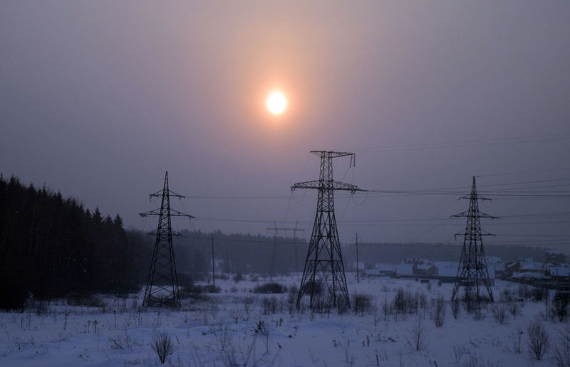 Sun Sky Snow Cable Winter Sunset Beauty In Nature Electricity  Electricity Pylon Cold Temperature Nature Technology Scenics - Nature Tranquil Scene Power Line  Tranquility Connection Field No People Outdoors Power Supply Winter Forest Sunlight Sunrise Landscape Rural Scene Fieldscape Lamp Sky And Clouds