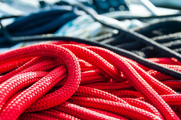 Snake pit on sailing boat Lines Snake Pit Backgrounds Close-up Connection Day Detail Full Frame Nautical Vessel No People Outdoors Red Rope Sailing Strength Tied Up