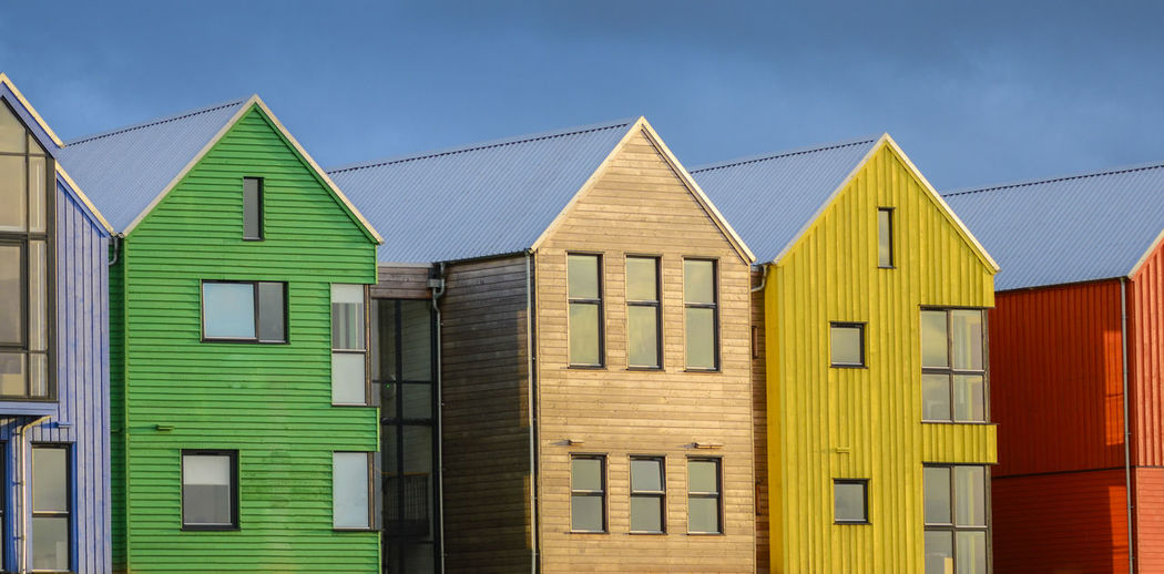 colored houses Architecture Blue Building Color Façade Geometry Green Highlands House John O'Groats Modern No People Outdoors Red Residential Structure Roof Scotland Symmetry Urban Window Yellow