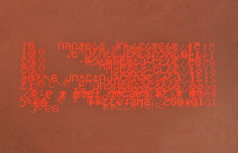 Red Communication Text Close-up Number No People Western Script Data Technology Indoors  Orange Color Studio Shot Connection Pattern Letter Wireless Technology Script Wall - Building Feature Sign Coding Computer Language Message