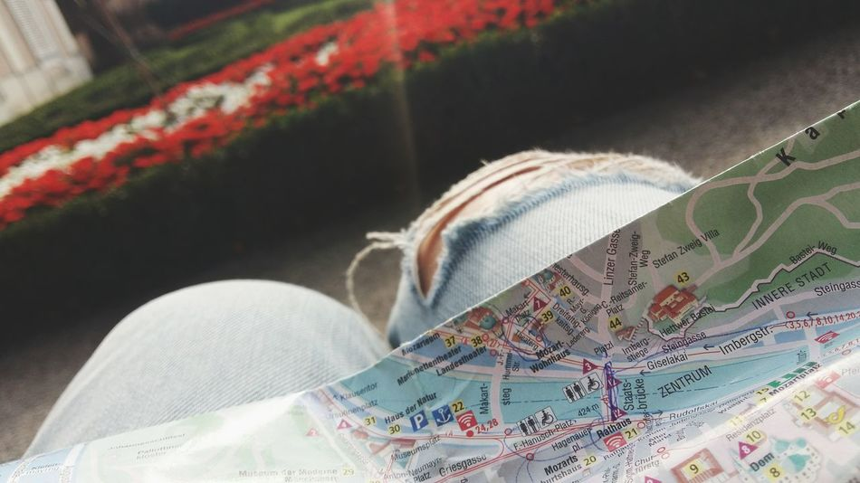 Map City Map Street Map Salzburg, Austria Focus On Foreground Knees Flowers