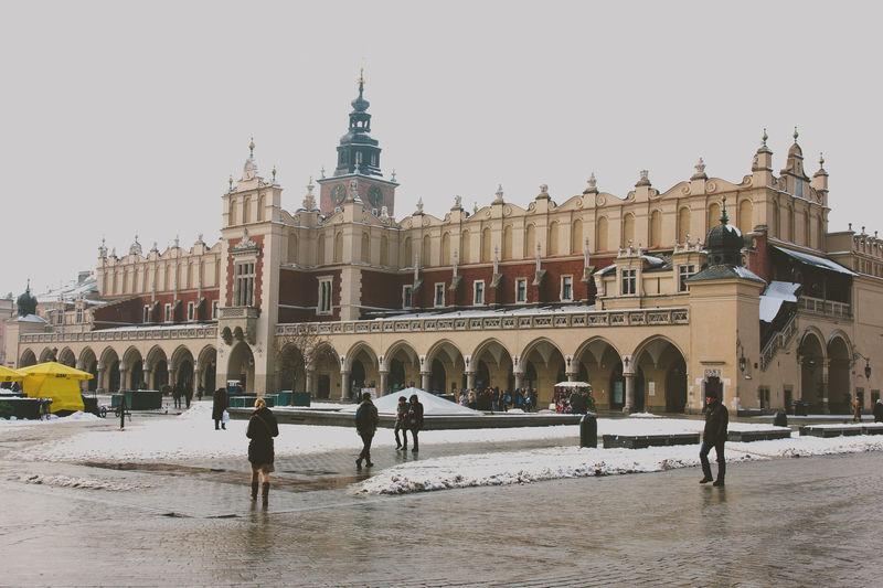 Krakow during the winter Architecture City History Krakow Market Square Poland Snow Sukiennice Winter