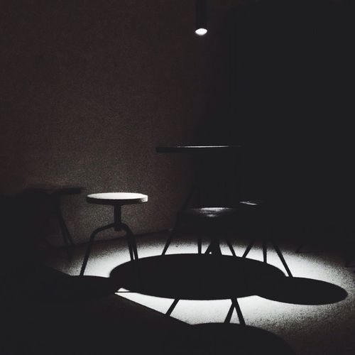 Chairs and table in illuminated room