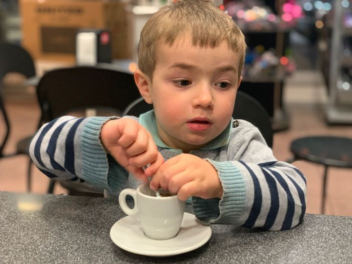 Coffee Child Childhood Males  One Person Real People Indoors  Men Innocence Focus On Foreground Drink Baby Food And Drink Mug Front View Young Drinking Boys Sitting Portrait Cup