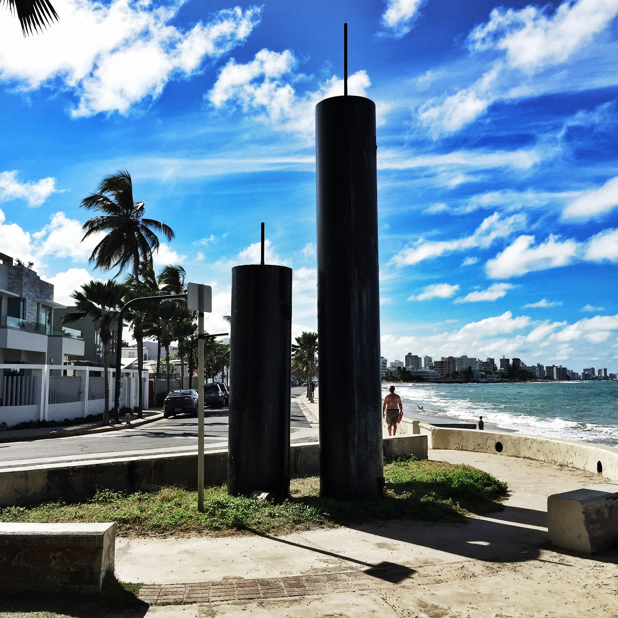 building exterior, sky, architecture, built structure, water, cloud - sky, cloud, sea, city, tree, sunlight, tower, day, beach, river, blue, outdoors, tall - high, incidental people, shore