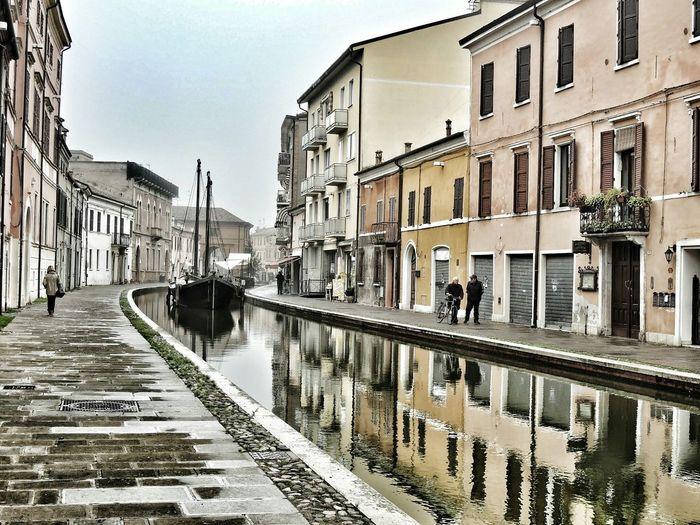 Reflection Water Canal Architecture Building Exterior Wet Built Structure City Sky Cultures Outdoors Gondola - Traditional Boat No People Day Comacchio Comacchiopiccolavenezia Comacchiocity