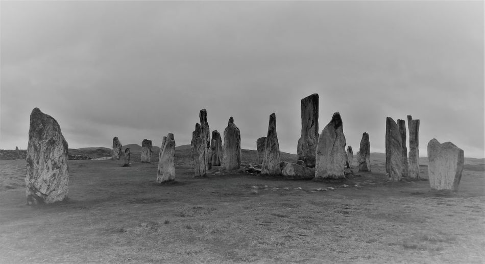 Megaliths on land against sky