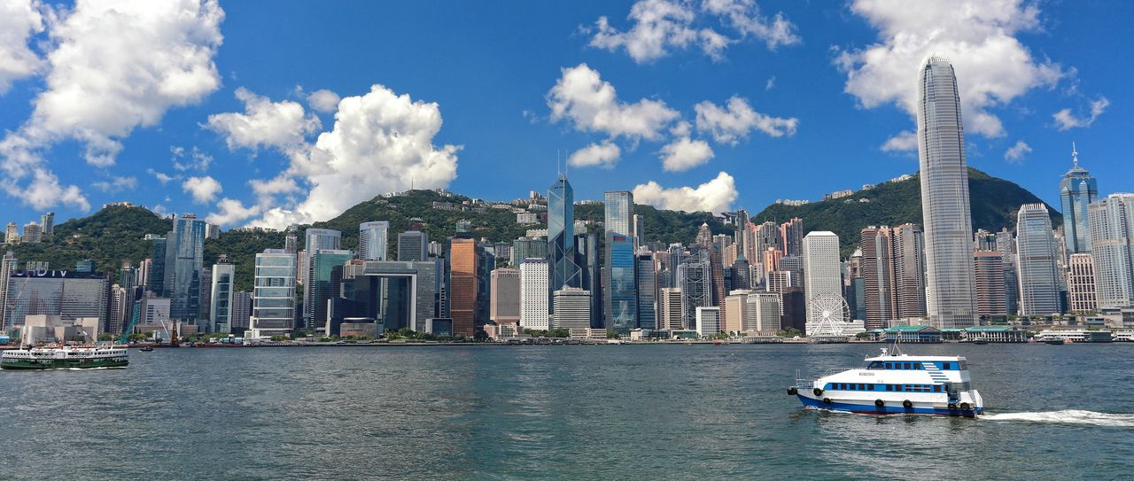 Architecture Building Exterior Built Structure City Cityscape Cloud - Sky Day Hong Kong Island Mode Of Transport Outdoors Sea Skyscraper Sunny Sunny Day Transportation Travel Destinations Urban Skyline Victoria Harbor Victoria Harbour Waterfront