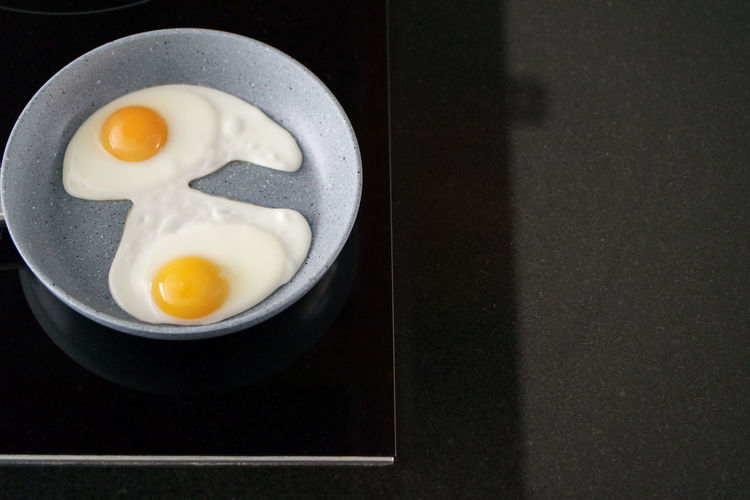 Egg Food Egg Yolk Indoors  Food And Drink Healthy Eating Fried Fried Egg Ready-to-eat Breakfast No People Wellbeing Still Life Directly Above Sunny Side Up Kitchen Utensil Frying Pan Preparation  Morning Helthyfood Protein Frying Pan Egg Yolk Egg White Easter Breakfast Frying Eggs Eggs Freshness High Angle View Table Close-up Yolk