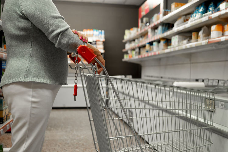Midsection of man standing at store