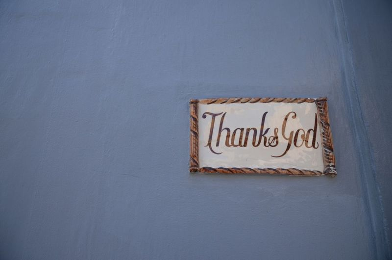 Low Angle View Of Thanks God Sign On Wall