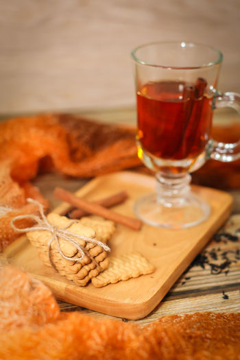 Close-up Cutting Board Drink Drinking Glass Food Food And Drink Freshness Glass Healthy Eating Hot Drink Household Equipment Indoors  No People Refreshment Still Life Table Table Knife Tea Tea - Hot Drink Tray Wood - Material