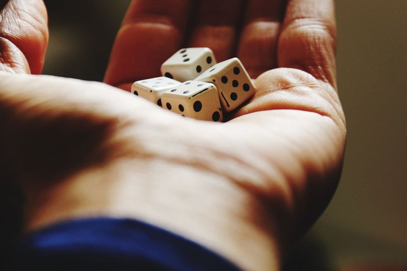 Luck Hand Dice Game Dice EyeEm Selects Human Hand Human Body Part One Person Holding Real People Close-up Leisure Activity Indoors  Day Chance People Gambling EyeEmNewHere This Is Masculinity