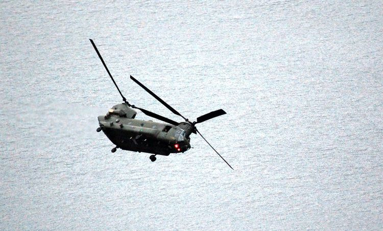 Royal Air Force Chinook flying low near Grasmere in the Lake Distict, uk Air Vehicle Chinook Day Flying Helicopter Military No People Outdoors Transportation Water