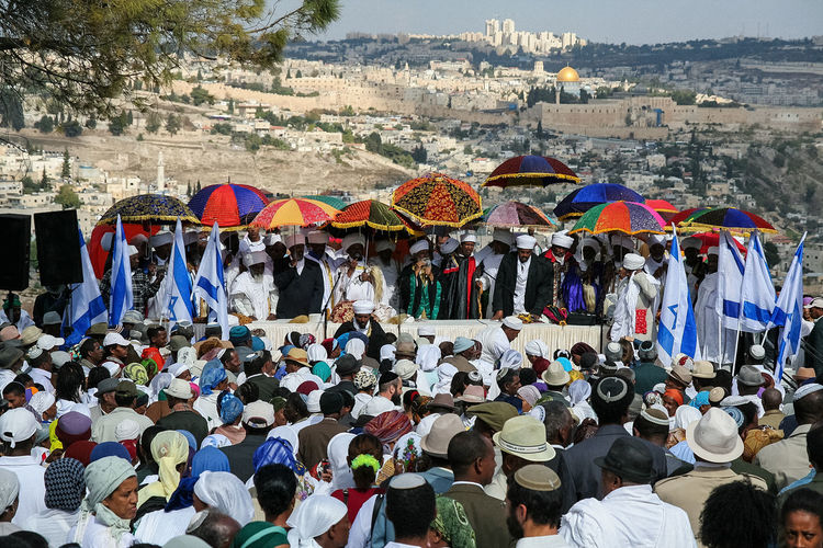 Ethiopian Jews celebrating the the background the Dome Of Rock. Sigdi Adult Architecture Building Exterior Built Structure City Crowd Day Group Of People High Angle View Large Group Of People Leisure Activity Lifestyles Market Men Nature Outdoors Real People Umbrella Women