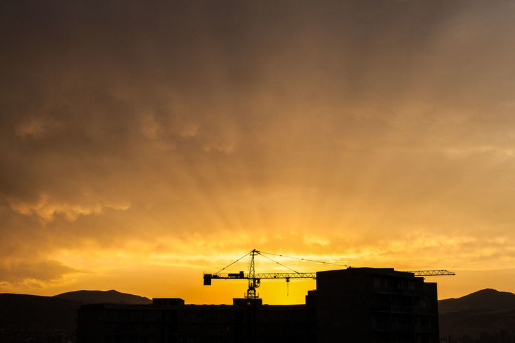 Yellow Sunset instagram.com/ebanoidze.photography Paint The Town Yellow Architecture Beauty In Nature Building Exterior Built Structure Cloud - Sky Crane - Construction Machinery Low Angle View Nature No People Orange Color Outdoors Silhouette Sky Sunset Technology Television Aerial