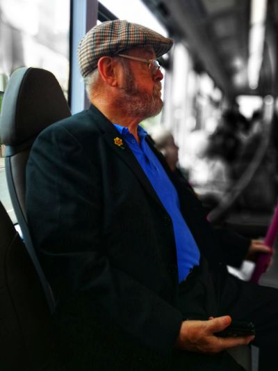Midsection of man standing in bus