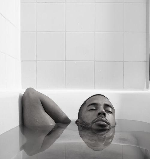 Portrait of man in bathtub