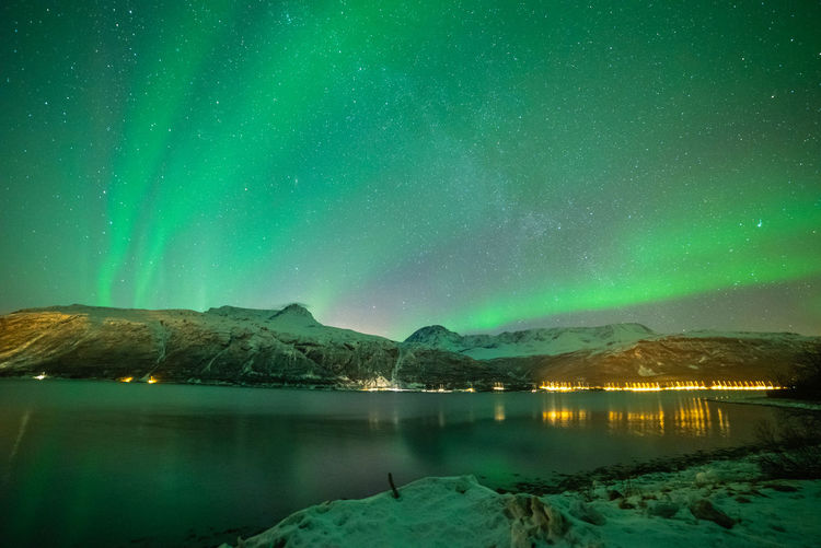 Scenic View Of Lake Against Aurora Borealis During Winter