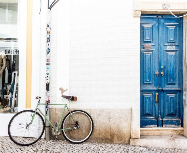Bicycle Door Mode Of Transport Outdoors Built Structure Stationary Day Transportation Building Exterior No People Architecture Land Vehicle City