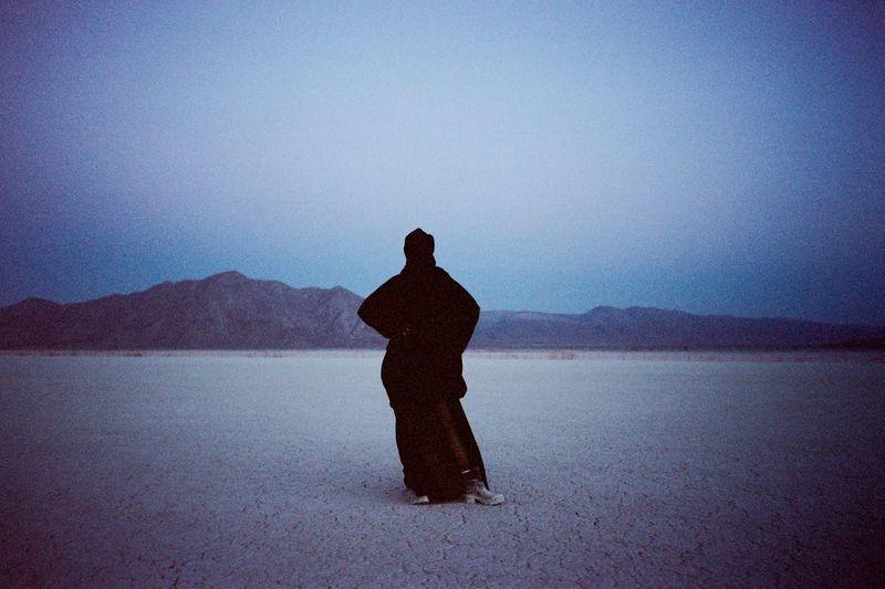 Alone in the desert Gloomy Magic Hour Sunset Horizon Burka  Black Widow Black Woman Pose Modelling Desert Landscape Desert Beauty Desert Silhouette Water One Person Nature Standing Lake Sky Scenics - Nature Salt Flat Tranquil Scene EyeEmNewHere