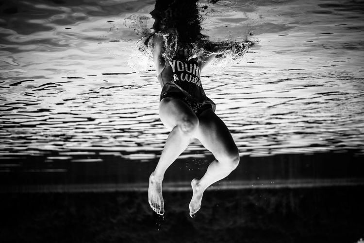Blackandwhite Leisure Activity Lifestyles Motion Swimming Upside Down Water Young Adult Young And Wild Young Women