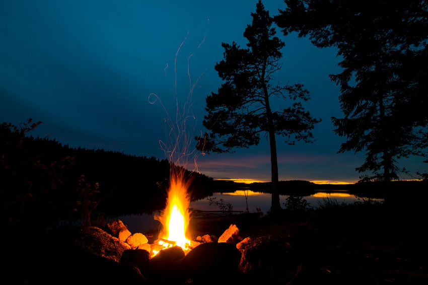 Allemansrätten Beauty In Nature Bonfire Bonfire Night Burning Campfire Camping Flame Forest Freedom To Roam Heat - Temperature Lake Nature Nature Night No People Outdoors Scenics Silhouette Sky Sunset Sweden Tranquility Tree Water
