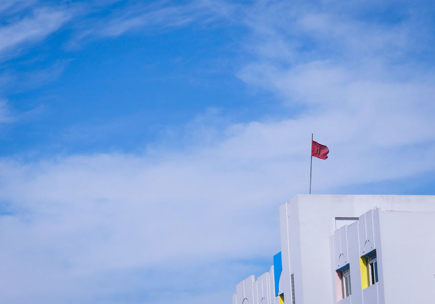 Made in Morocco 🇲🇦 Flag Symbol Patriotism Blue Sky Red Wind Outdoors Politics And Government Open Space Copy Space MnM MnMl Mnmlsm Minimalism Minimal Minimalistic Minimalmood Minimalist Minimalobsession Minimalart Minimalarchy Mobilephotography Shootermag
