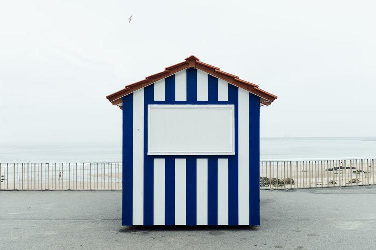 Beach hut against clear sky