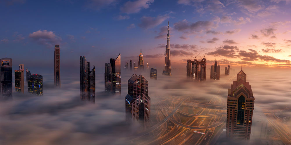 High Angle View Of City Amidst Cloudscape During Sunset