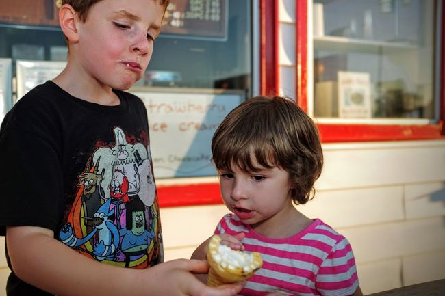 A day in the Life. August 12, 2016 Friend, Nebraska 35mm Camera Americans Brother & Sister Camera Work Casual Clothing Color Photography EyeEm Best Shots Eyeemphoto Focus On Foreground FUJIFILM X100S Ice Cream Ice Cream Cone Nebraska Off Camera Flash Photo Essay Rural America Selects Sharing  Sharing A Moment Shoot Your Life Small Town Stories Storytelling Summertime The United States Togetherness