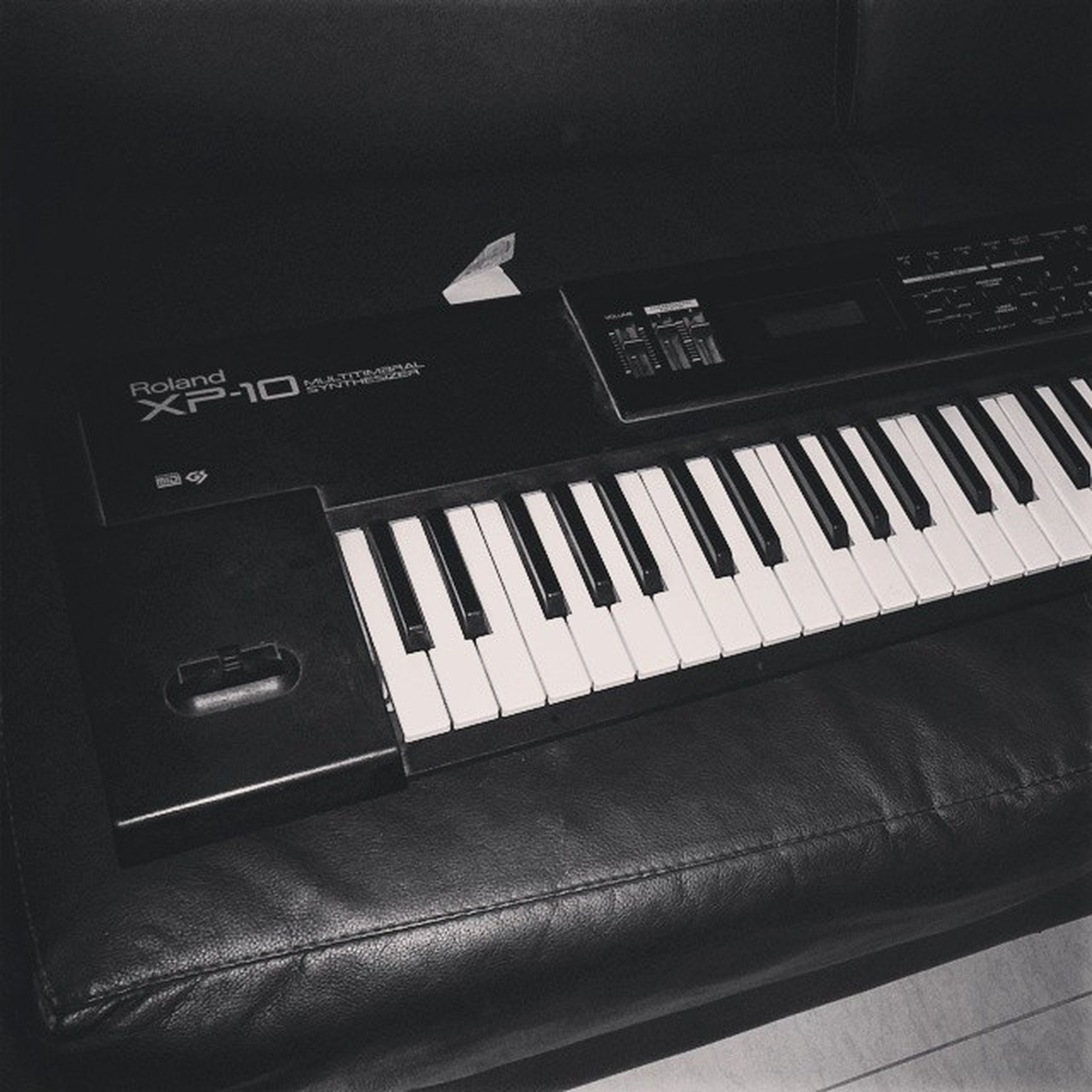 communication, indoors, text, western script, technology, close-up, music, number, arts culture and entertainment, capital letter, wireless technology, high angle view, connection, musical instrument, no people, piano key, computer keyboard, piano, laptop, control