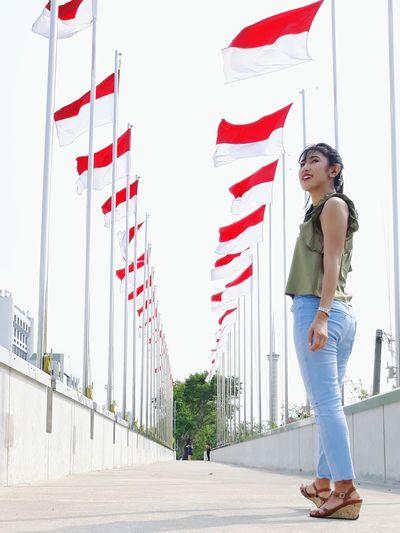 Merah Putih teruslah kau berkibar People Woman Indonesia Photography  Indonesian INDONESIA IndonesiaFlag Redandwhite EyeEm Selects Full Length Standing Childhood Sky National Icon National Flag Patriotism Flag Fluttering Fluttering