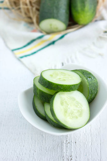 Close-up of cucumber in bowl on table
