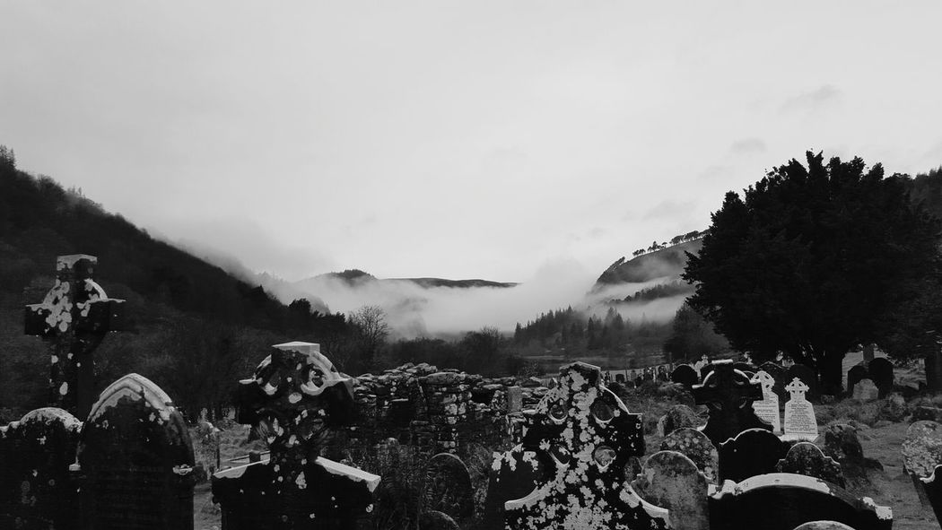Graveyard Cloud - Sky Sky Outdoors Nature Day Mountain Beauty In Nature Mountain Peak Tree Fog Glendalough Ireland Lovers Ancient History Architecture Ancient Religion No People SpookyHalloween Graveyard Collection