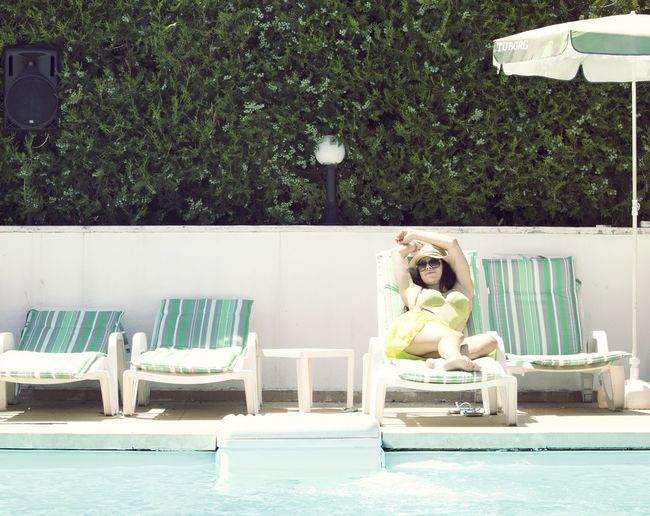 Woman around the pool Beautiful Hat Relaxing Shopping Summertime Woman Girl One Person Poolside Sexygirl Summer Sun Sunbathing